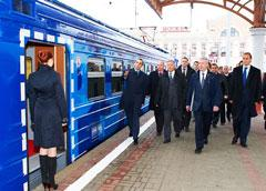 Alexei Krivoruchko shows the new train design to the guests