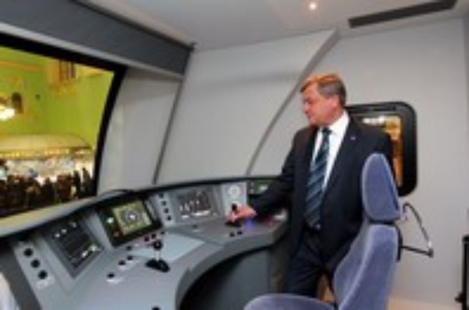 V. Gapanovich, Senior Vice-President of JSC RDZ, in the driver's cab of the Lastochka train. Photograph provided by RZD.